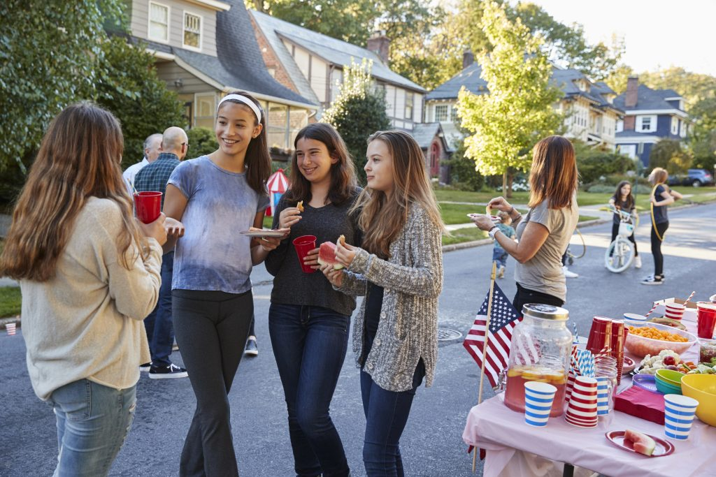 Friends and family gather for fun and games as a summer block party