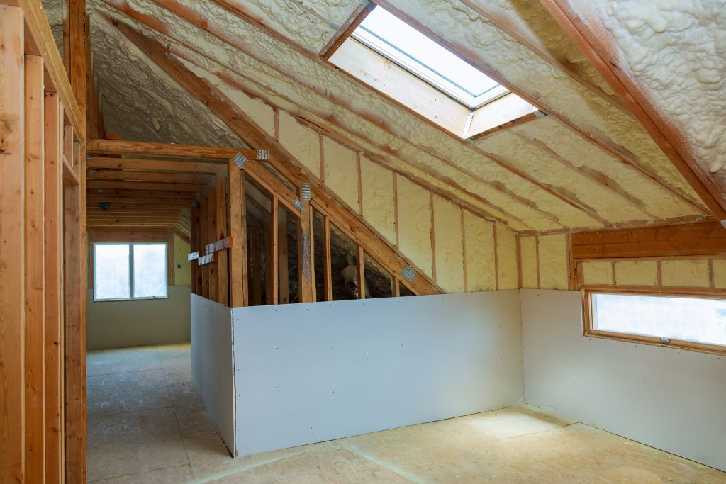Foam insulation installed in the walls and attic ceiling of the house